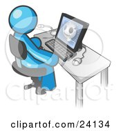 Clipart Illustration Of A Light Blue Doctor Man Sitting At A Computer And Viewing An Xray Of A Head