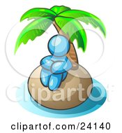 Clipart Illustration Of A Light Blue Man Sitting All Alone With A Palm Tree On A Deserted Island