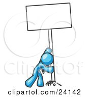 Strong Light Blue Man Pushing A Blank Sign Upright