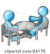 Clipart Illustration Of Two Light Blue Business Men Sitting Across From Eachother At A Table During A Meeting