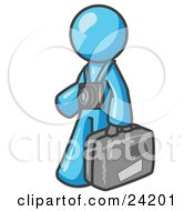 Clipart Illustration Of A Light Blue Male Tourist Carrying His Suitcase And Walking With A Camera Around His Neck