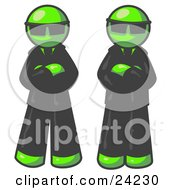 Two Lime Green Men Standing With Their Arms Crossed Wearing Sunglasses And Black Suits