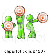 Clipart Illustration Of A Group Of Three Lime Green Men Holding Red Targets In Different Positions