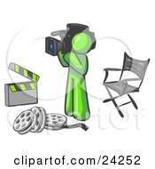 Clipart Illustration Of A Lime Green Man Filming A Movie Scene With A Video Camera In A Studio