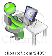 Clipart Illustration Of A Lime Green Doctor Man Sitting At A Computer And Viewing An Xray Of A Head