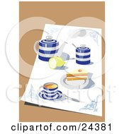 Blue And White Tea Set With A Pot Lemon Cups And Saucers And Cake Sitting On A Cloth