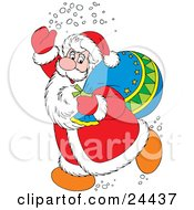Santa Claus In A Red And White Suit Waving And Treading Snow Carrying A Toy Sack Over His Shoulder by Alex Bannykh