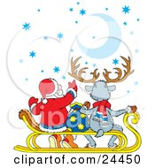 Santa And A Reindeer Sitting On A Sled And Gazing Up At The Stars And Moon