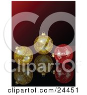 Clipart Illustration Of Two Golden And One Red Mirror Disco Ball Ornaments On A Reflective Surface Over A Gradient Red Background