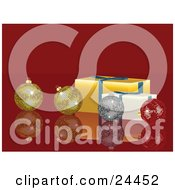 Two Gold One Silver And One Red Disco Ball Ornaments On A Reflective Red Surface With Yellow And White Presents