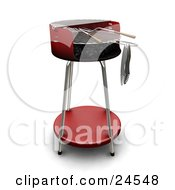 Wood Handled Utensils On A Red Bbq Grill