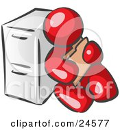 Clipart Illustration Of A Red Man Sitting By A Filing Cabinet And Holding A Folder by Leo Blanchette