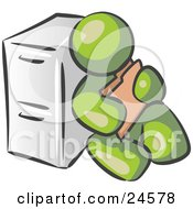 Olive Green Man Sitting By A Filing Cabinet And Holding A Folder