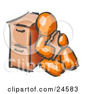 Painted Orange Man Sitting By A Filing Cabinet And Holding A Folder