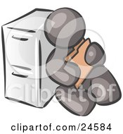 Clipart Illustration Of A Gray Man Sitting By A Filing Cabinet And Holding A Folder by Leo Blanchette