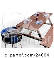 Cooking Utensils Top Of A Blue Bbq Grill By A Picnic Table Set With Plates And Cups