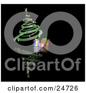 Green Spiraled Christmas Tree With Gold Ornaments And A Gold Star Over Presents On A Reflecting Black Surface