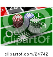 Stacked Red Green And Blue Poker Chips On A Roulette Playing Table In A Casino