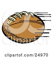 Fast Brown Leather American Football Speeding Through The Air During A Game
