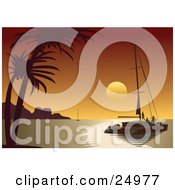 People Enjoying A Beautiful Orange Tropical Sunset From The Deck Of A Sailboat