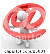 White Person Holding A Red Email At Symbol With His Head Peeking Through The Center