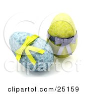 Clipart Illustration Of Two Decorated Blue And Yellow Easter Eggs With Yellow And Silver Bows