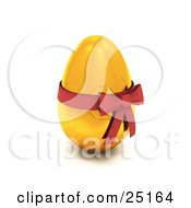 Gold Easter Egg With A Honeycomb Pattern And A Red Bow And Ribbon Around It