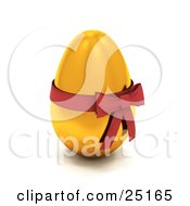 Gold Easter Egg With A Red Bow And Ribbon Around It