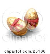 Two Golden Patterned Easter Eggs With Red Bows