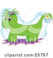 Clipart Illustration Of A Green Christmas Dragon Wearing A Christmas Ornament On Its Tail by bpearth