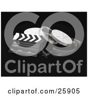 Clapperboard And Film Reel Cans Over Black