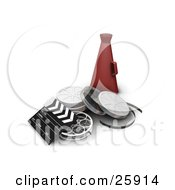 Clapboard Film Reels And Red Directors Cone On White