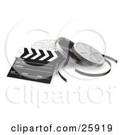 Clapperboard And Film Reel Cans Over White