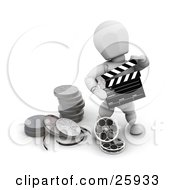 Clipart Illustration Of A White Character Holding A Clapper And Standing With Film Reels At His Feet