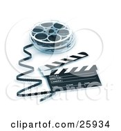 Film Emerging From A Reel Resting Beside A Clapper Board Blue Toning