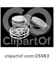 Clipart Illustration Of An Open Movie Film Reel And Cases Over A Reflective Black Surface
