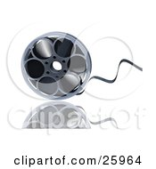 Film Coming Out Of A Metal Reel Over A Reflective White Surface