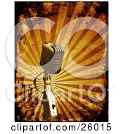 Clipart Illustration Of A Retro Microphone Over A Bursting Orange Background With Grunge Splatters by KJ Pargeter