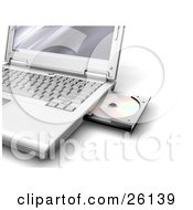 Notebook Computer With A Disc In The Open Drive