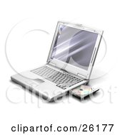 Clipart Illustration Of A Silver Laptop With A Disc In The Open Drive Over White