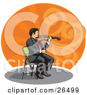 Professional Male Violinist Sitting In A Chair And Playing A Violin