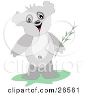 Friendly Gray Koala Bear Holding Twigs Of Bamboo And Smiling