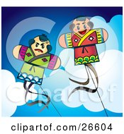 Couple Of Fighting Japanese Kites Flying Above The Clouds In A Blue Sky