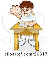 Little School Boy Sitting At His Desk With A Book And Raising His Hand To Ask Or Answer A Question