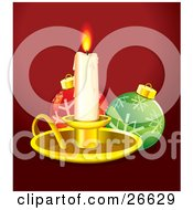 Melting Lit Candlestick In A Golden Tray Casting Light On Red And Green Christmas Ornaments With Snowflake Designs Over Red