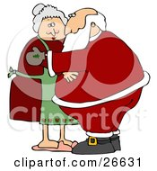 Santa And Mrs Claus Embracing Each Other In A Hug