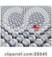 Shiny Red Ball Standing Out In A Crowd Of Silver Balls