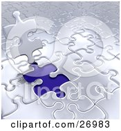 Silver Jigsaw Puzzle Piece Standing Up Over A Blue Space