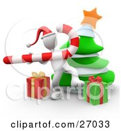 White Person Wearing A Santa Hat And Dancing With A Candy Cane In Front Of A Christmas Tree And Presents