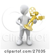 White Person Accepting A Golden Entertainment Trophy During A Ceremony
